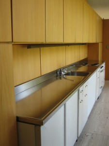 Innovative one-piece stainless steel countertop in the Farnsworth House.
